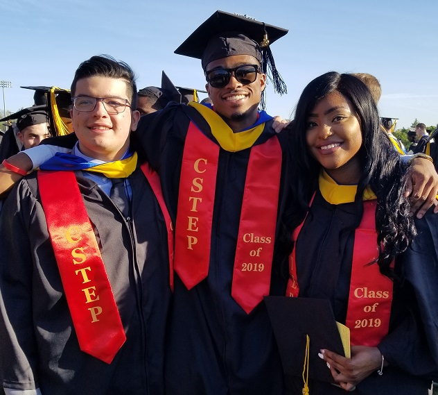 Three CSTEP students posing in cap and gown