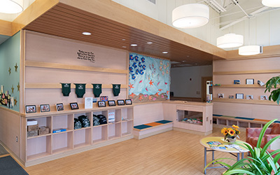 Children's center lobby with toys and colorful wall art