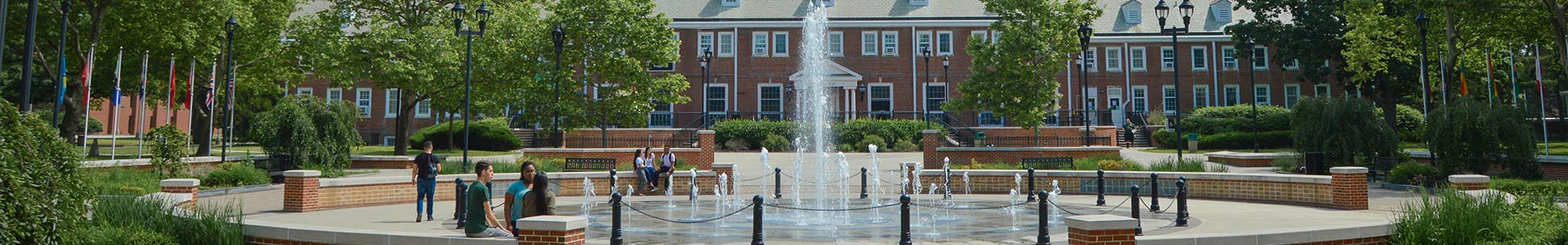 Bunche Plaza fountain with students.