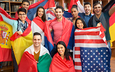 Many students wrapped in international flags