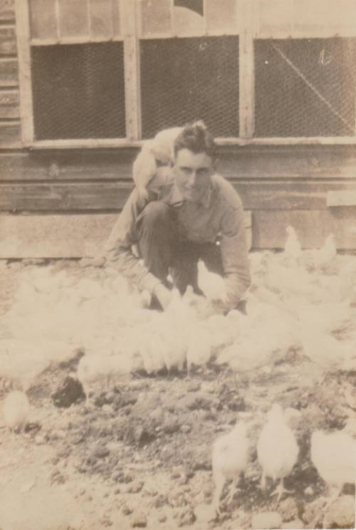 Southard on his farm in Red Hook with chicken. Circa 1922
