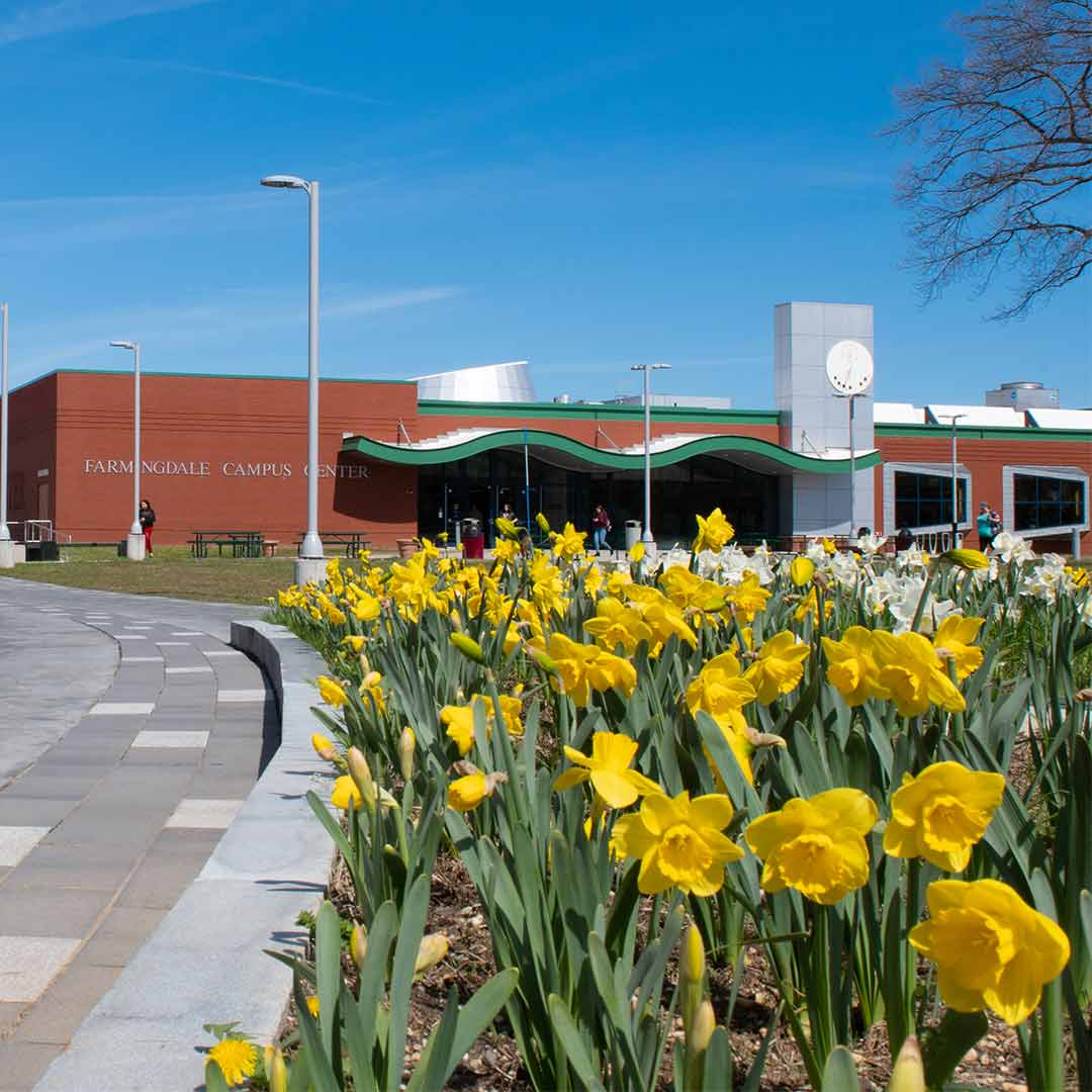 Campus Center with daffodils