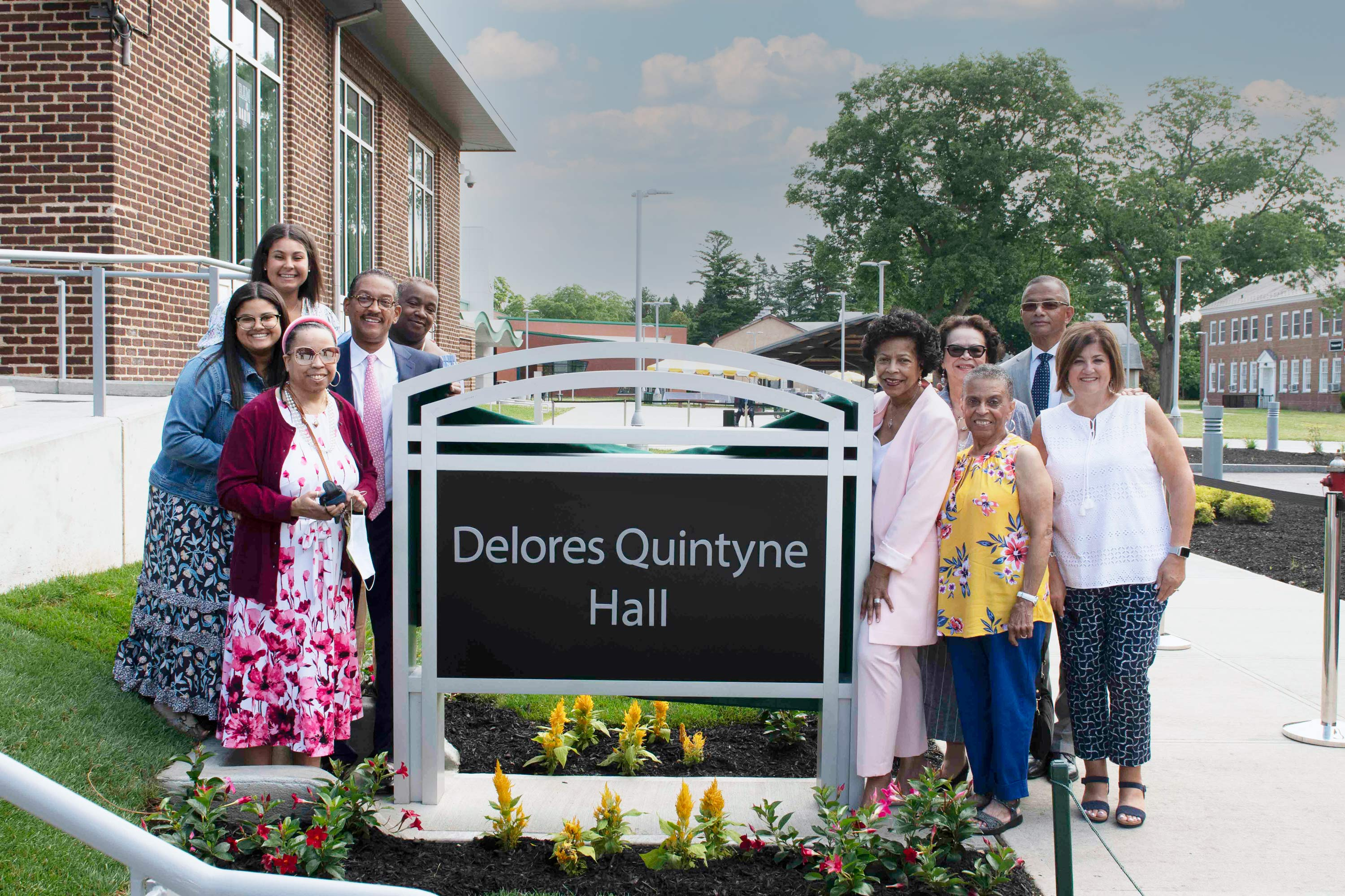 Delores Quintyne Hall Sign with Family Gathered Around