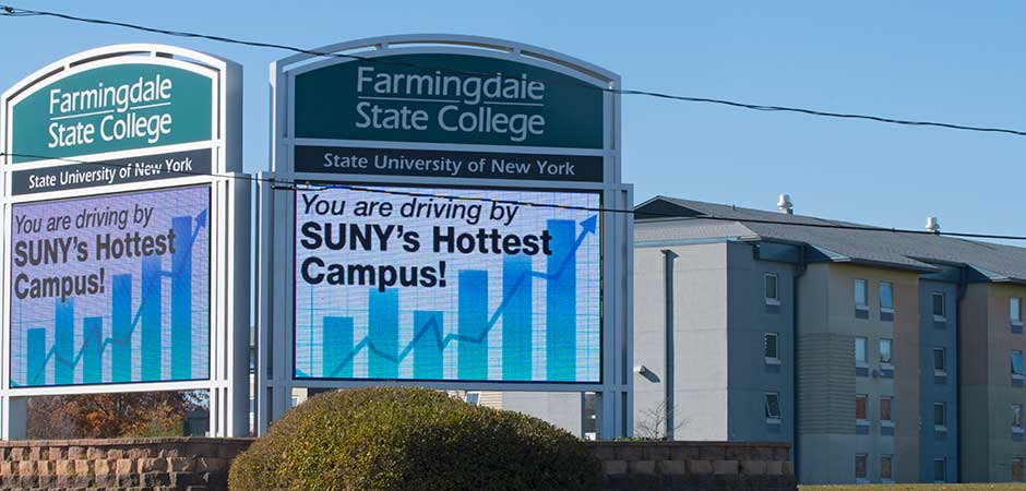 Electronic signs at the Melville campus entrance.