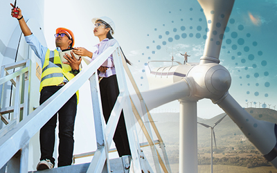 Wind turbine with two workers in hard hats