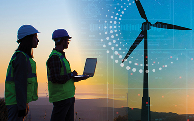Male worker in hard hat examining a wind turbine