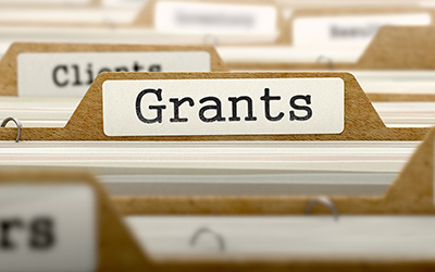 File folders with a title of Grants