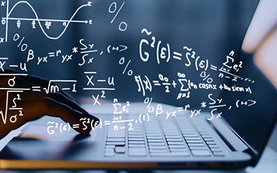 Math equations floating above a laptop keyboard.